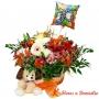 Canastillo de Cumpleaños mediano con flores mix primaverales más peluche y globo