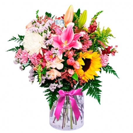 Florero en con Liliums Rosados Girasoles Mables y Solidagos y flores mix