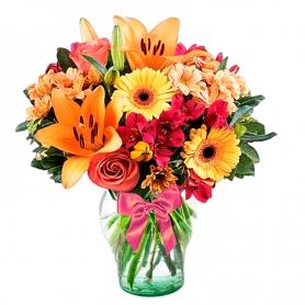Florero en tonos Naranja con 6 Rosas 6 Gerberas 6 Mables y 6 varas de Liliums