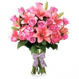 Florero con 12 Rosas Rosadas y 10 Liliums rosados más flores mix